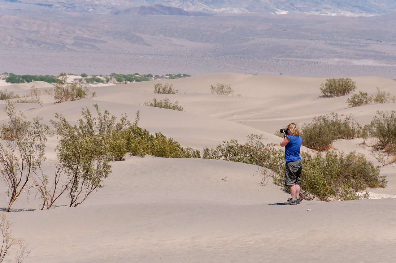 Female photographer capturing the sand dunes in Death Valley