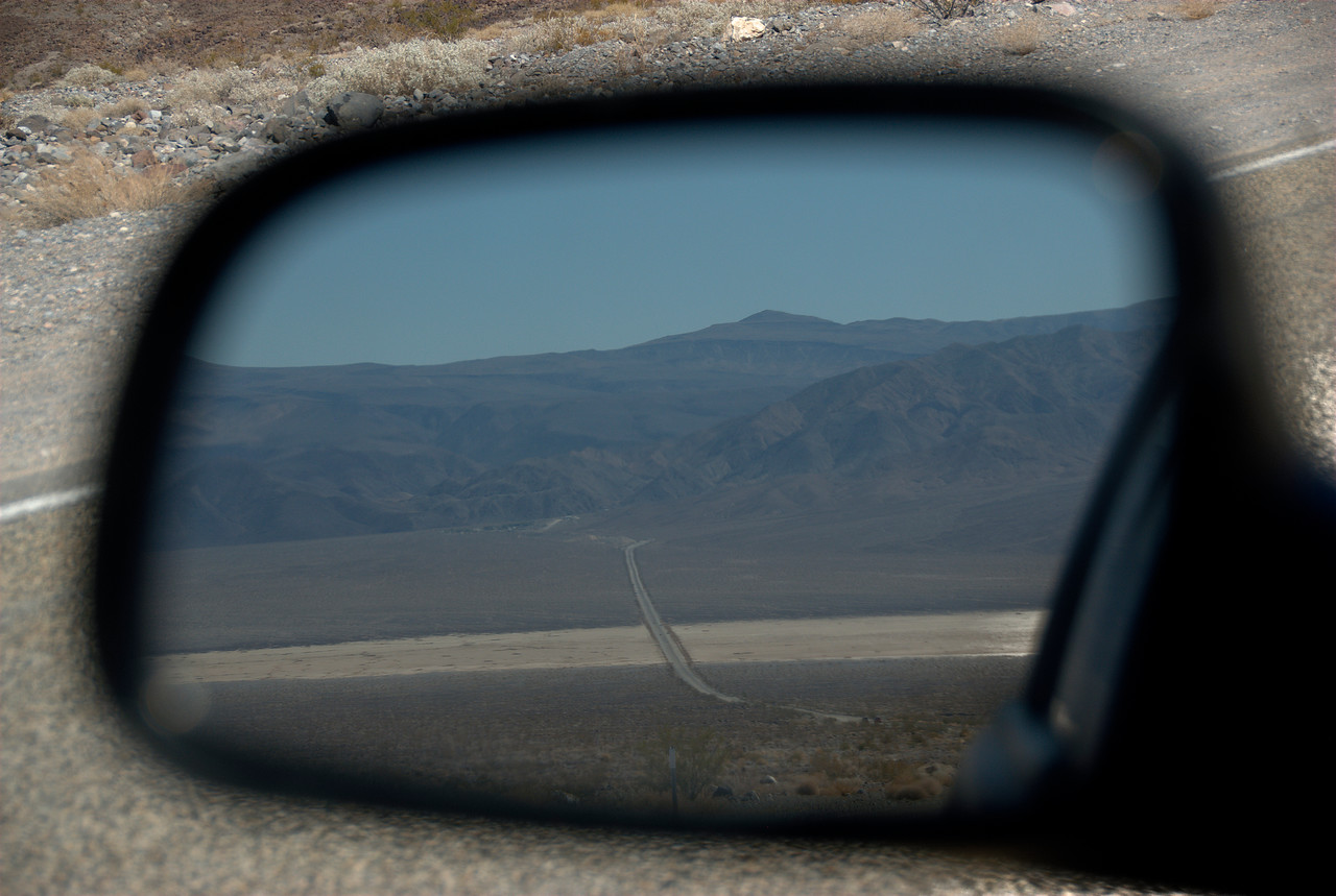 The road to Death Valley from car's side mirror - California