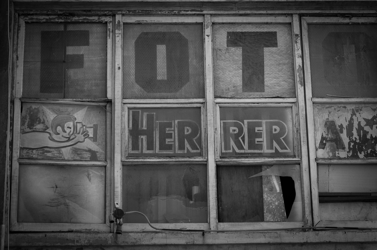 B&W shot of a window in an old building in Los Angeles, California