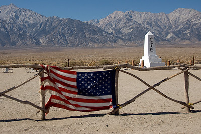 American flag near monument at Manzanar cemetery in California