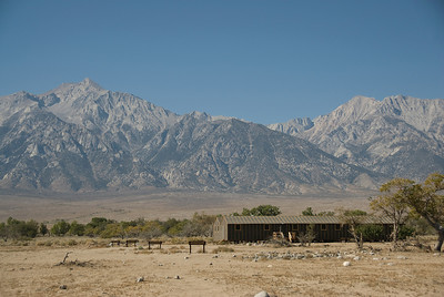 The Sierra Nevada Mountains rise behind barracks at Manzanar National Historic Site in the Owens Valley