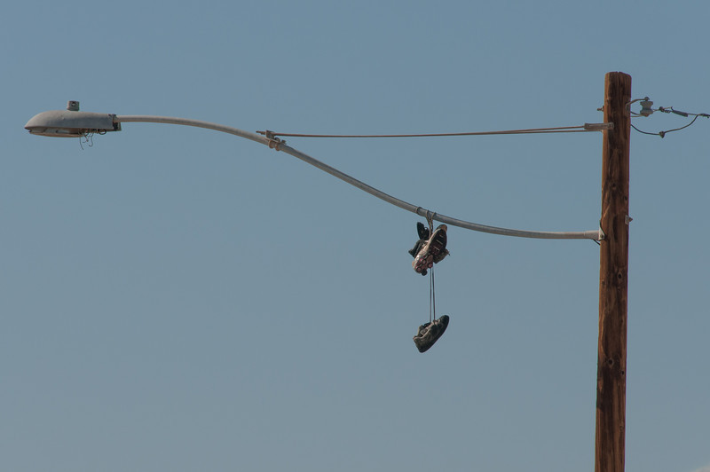 Shoes tied on a lamp post in Salton Sea, California