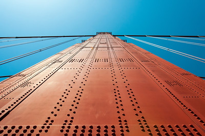 Looking up the tower of Golden Gate Bridge in San Francisco, California