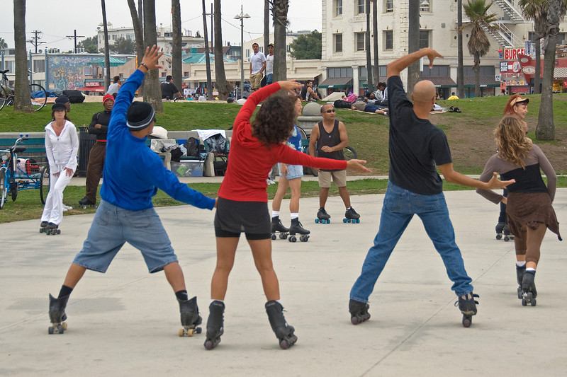 Locals on roller blades at a public park in Venice Beach, California