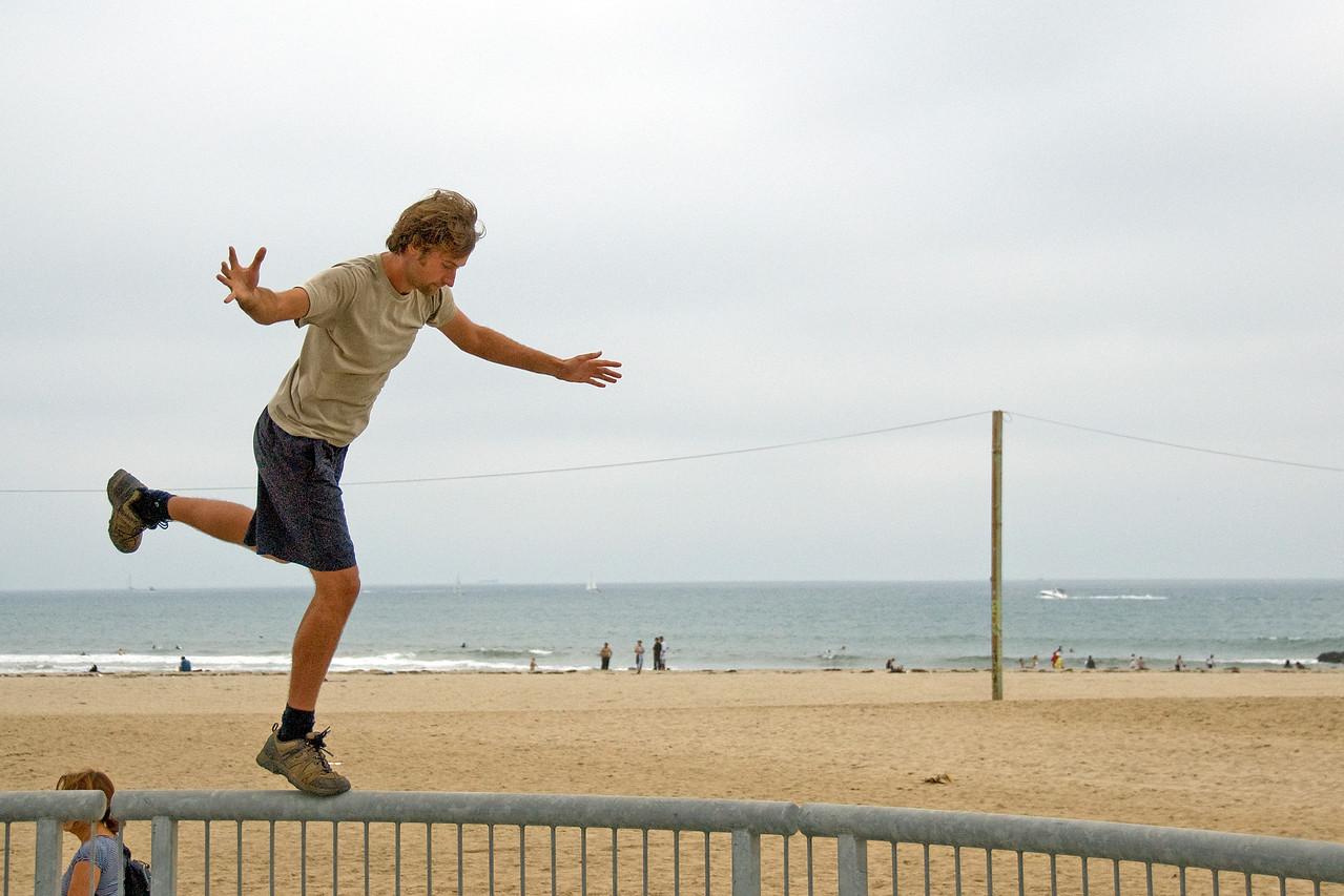 Man balancing on a railing in Venice Beach, California