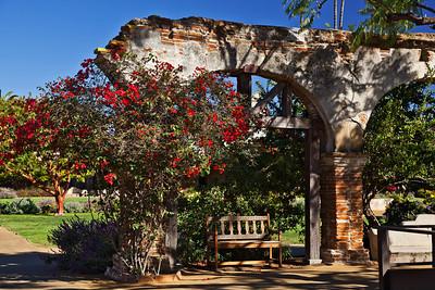 San Juan Capistrano, California A bench under an archway at the Mission San Juan Capistrano.
