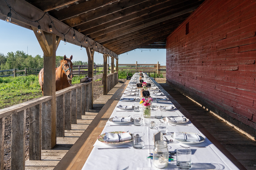 Long table set up for dinner at the Old Red Barn in Leduc, Alberta