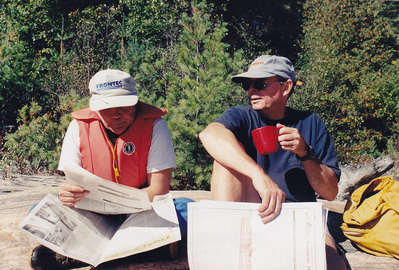 Bill Williams & Ted Johnson reading the paper
