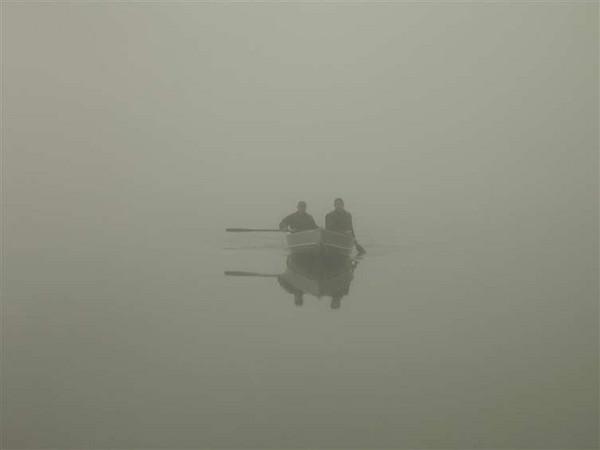 Paddling in the fog on lake Tarmigan
