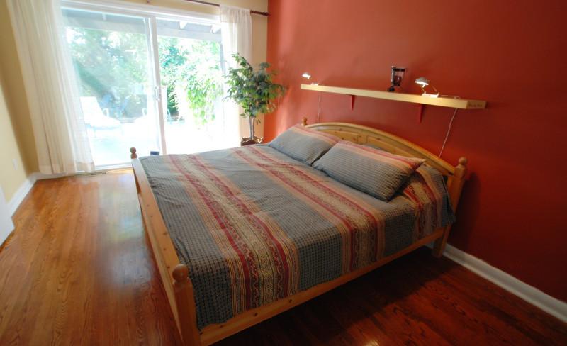 master bedroom with sliding door to back deck
