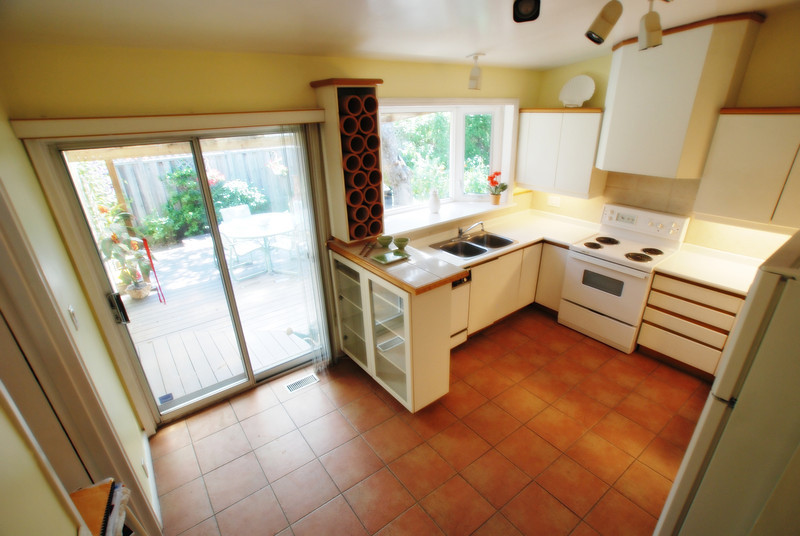 bright kitchen with door to side patio