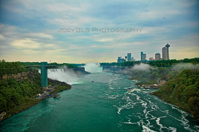 Niagara Falls, including the American Falls and the Horseshoe Falls, taken from the Rainbow Bridge.