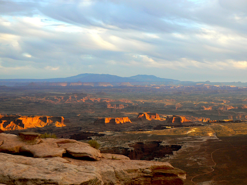 Rocks glow red from a Canyonlands sunset.