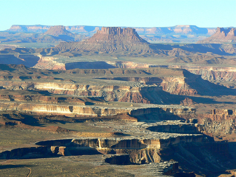 Mesas and canyons cut deep into the earth can be seen at the Green River overlook in Canyonlands National Park.