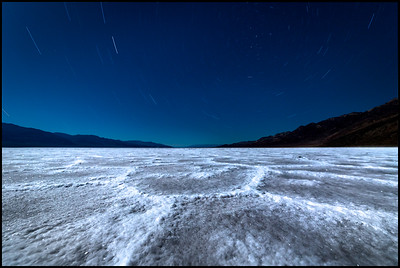 Star trails at Badwater Basin under moonlight