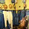Used overalls and other clothing for sale at Mosswood Farm Store and Baker in Micanopy, Florida.