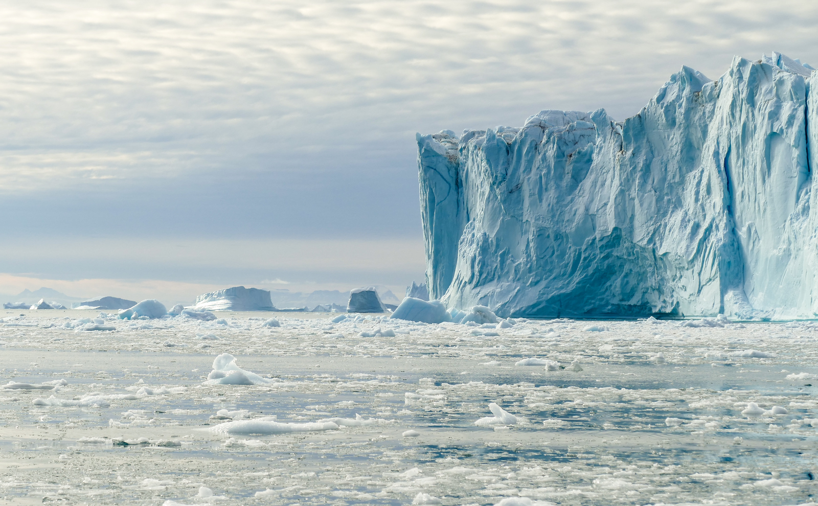 On a luxury cruise expedition, explore the icebergs of Greenland. Click through to read about this fun, boomer travel adventure with Silversea Cruises. #adventure #Greenland #bucketlist