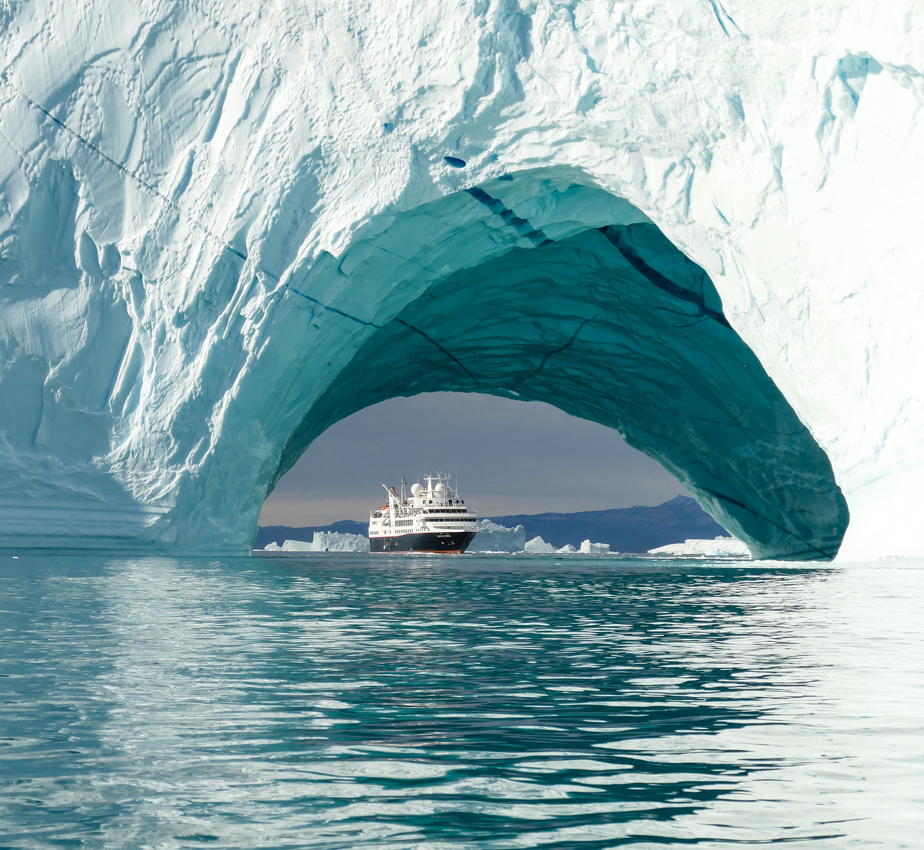 Explore Greenland's icebergs on a luxury expedition cruise. Click through to read more about our boomer travel adventure. You'll be adding this one to your bucket list! #cruise #Greenland #boomertravel