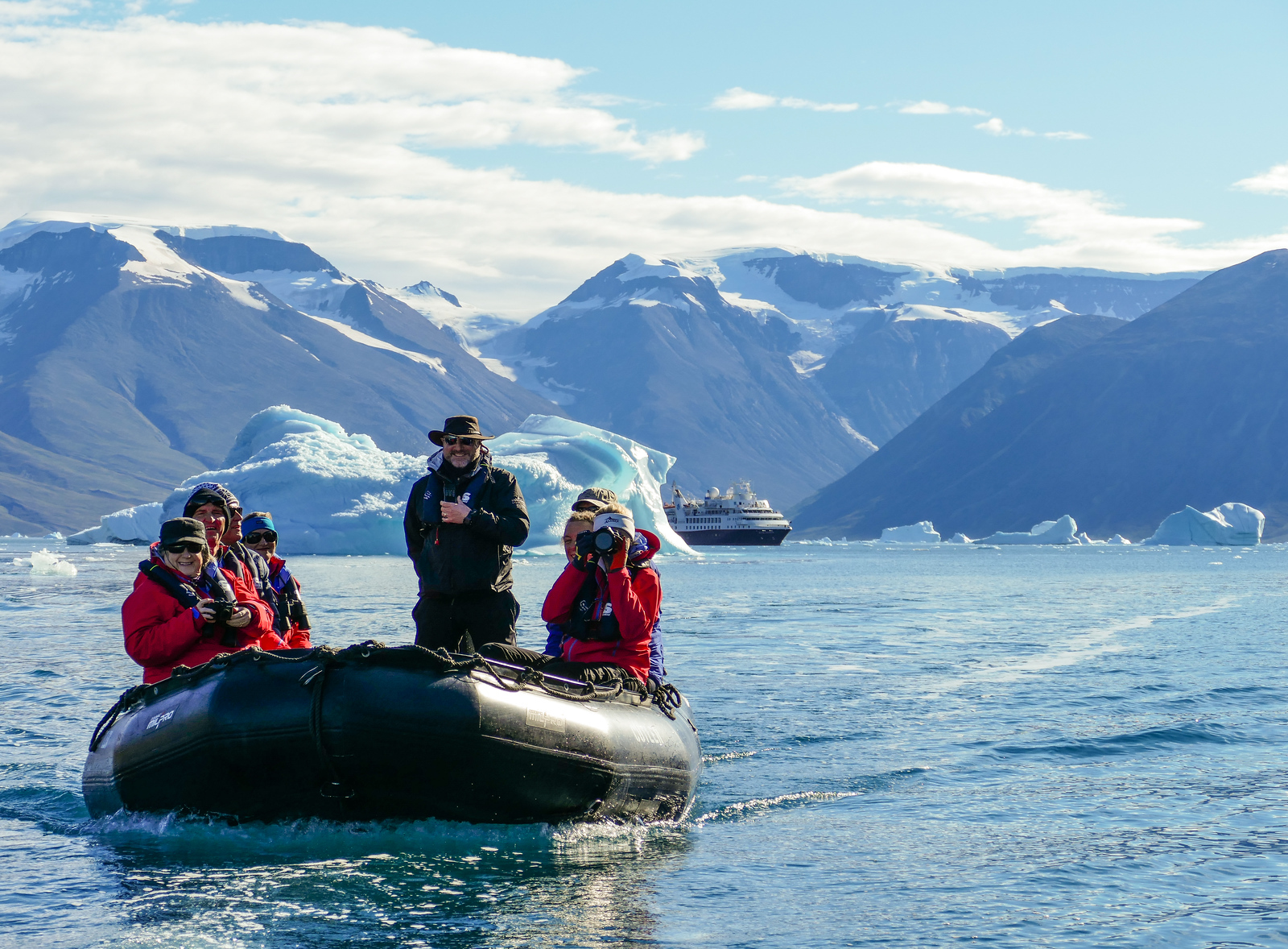 Happy cruisers on their way to explore the iceberg graveyard at Red Island.