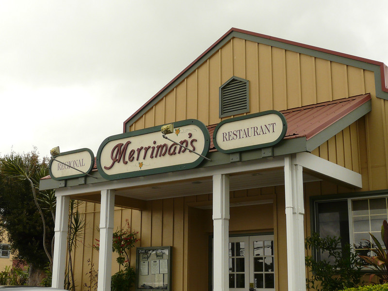 Merriman's Restaurant sign hangs on the outside of the building. A great place to find slow food dining in Hawaii.