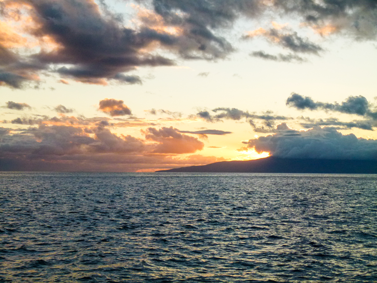 The setting's spectacular on a Maui sunset cruise.