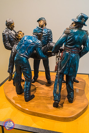 Sculpture of Lincoln being carried from the Ford Theater in the Entrance to the Genealogy Center (©simon@myeclecticimages.com)