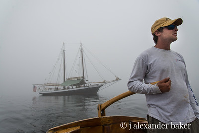 Captain Andy at the Tiller of the Yawl Boat, Mercantile at Anchor - 2 in series