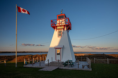 Canadian flag with Wood Islands Rear Range Light