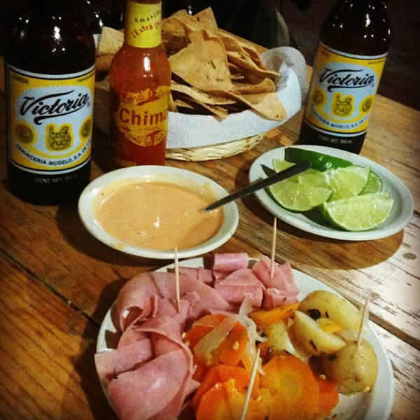 What happens when you order 2 beers in #Oaxaca, Mexico. Lots of fun snacks & goodies included.