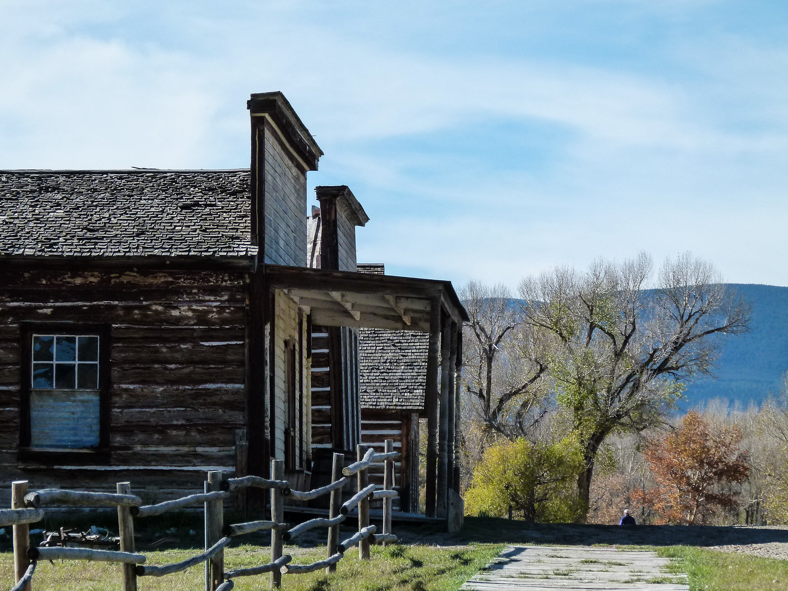 Log buildings line the sidewalk at Bannack Ghost Town in Montana