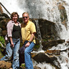 Donna and Alan Hull pose in front of Skalkaho Falls, Bitterroot National Forest, Montana