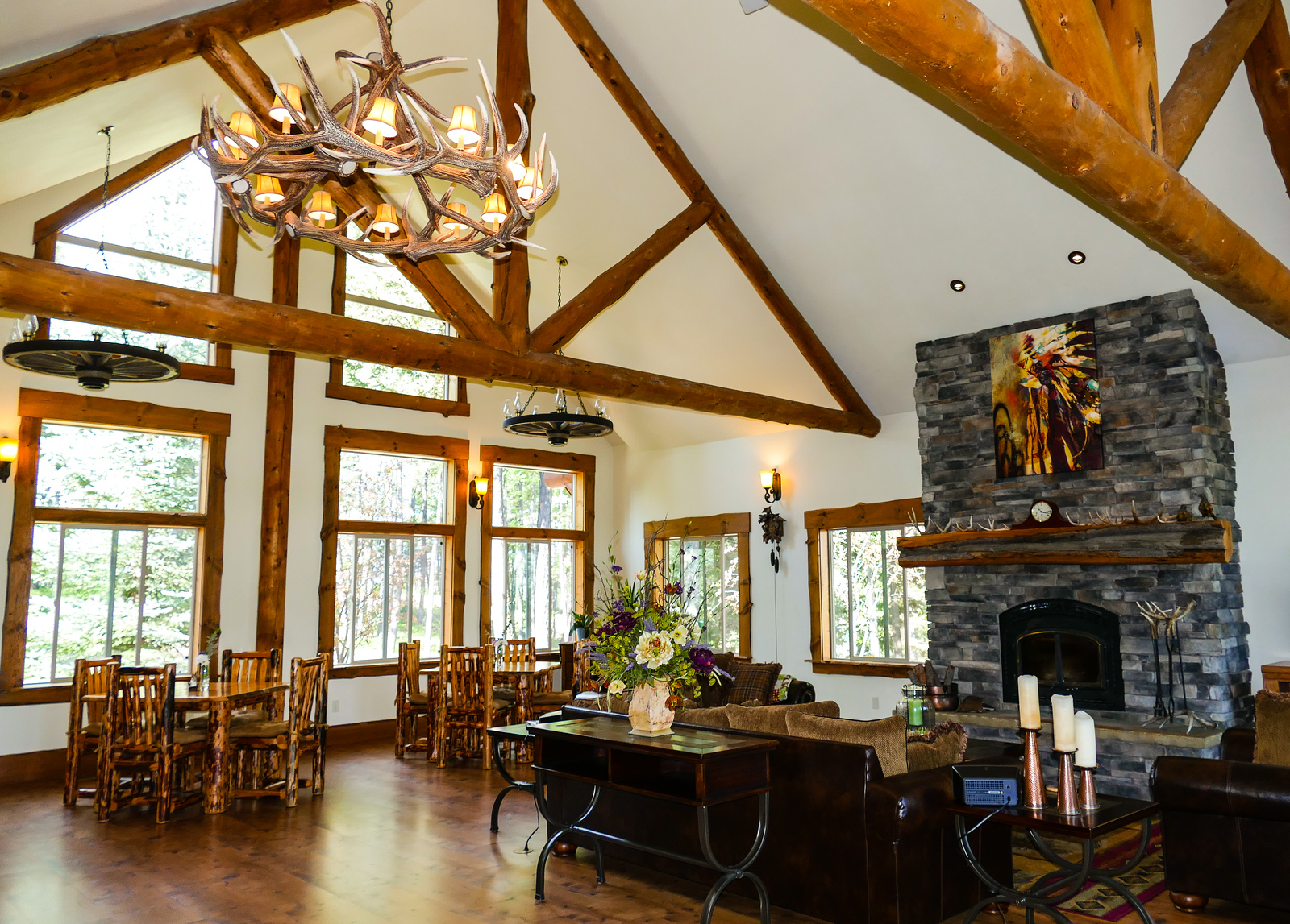 The great room at Dreamcatcher Lodge offers a rustic decor with plenty of seating. You'll find this luxurious lodge in Kalispell, Montana.