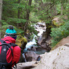 Donna Hull takes a photo of Avalanche Creek