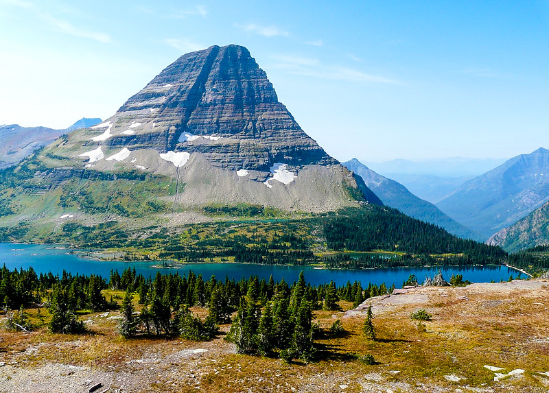 Mountain bordered by a lake at Glacier National Park.