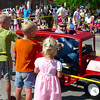 Children wait for the candy handout at the Creamery Picnic Parade