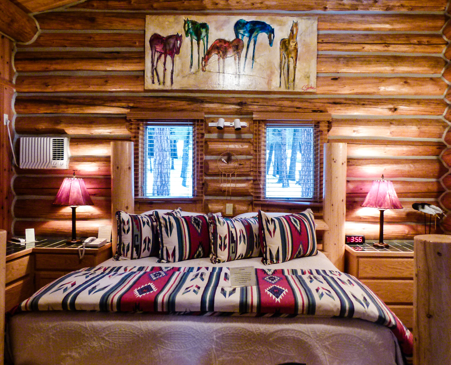 Bedroom interior in a Triple Creek Ranch log cabin.