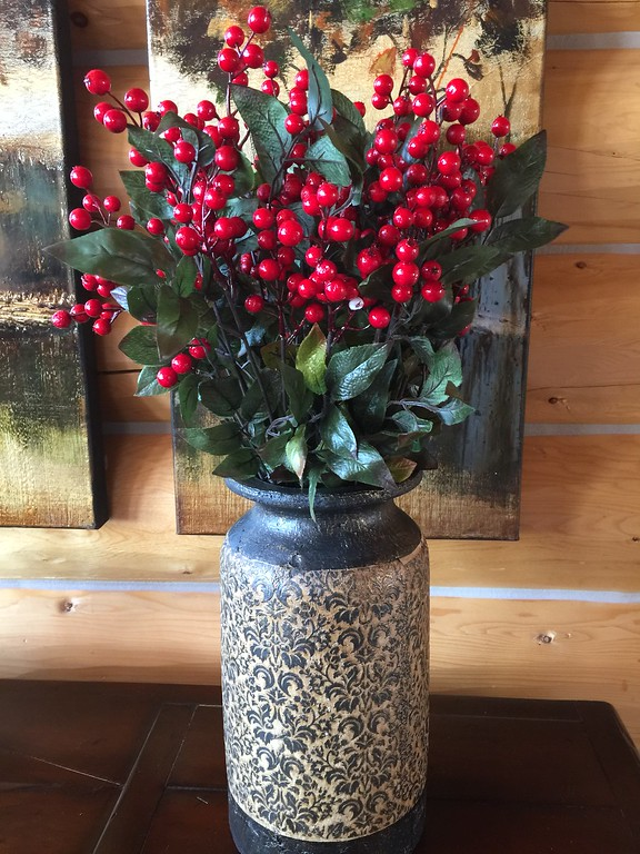 Red berries and greenery in a container