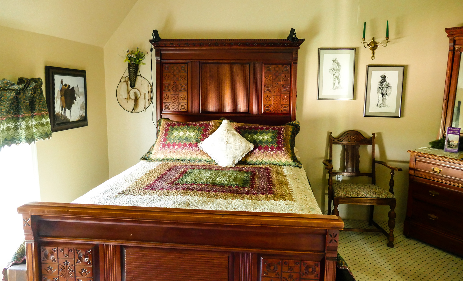 Bed with heavy wood headboard and footboard in a bed and breakfast in Nebraska.