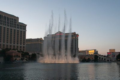 Fountains of Bellagio with Caesars Palace in the background - Las Vegas