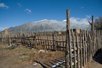 Landscape of Taos Pueblo with a view of the Sangre de Cristo Mountains, New Mexico