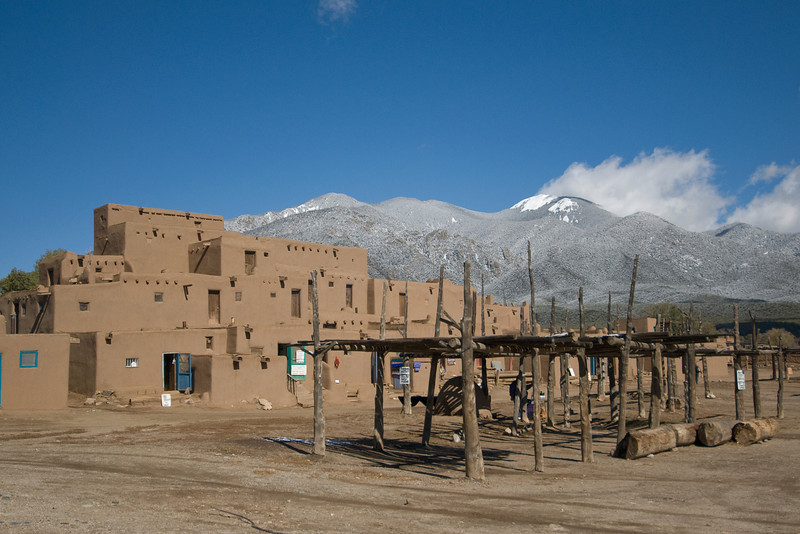 Adobe architecture and Sangre de Cristo Mountains in Taos Pueblo, New Mexico