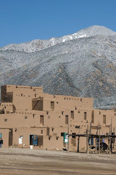 Sangre de Cristo Mountains behind architecture in Taos Pueblo, New Mexico
