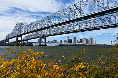 New Orleans, Louisiana A view of the New Orleans skyline underneath the dual bridges of the Crescent City Connection over the Mississippi River.