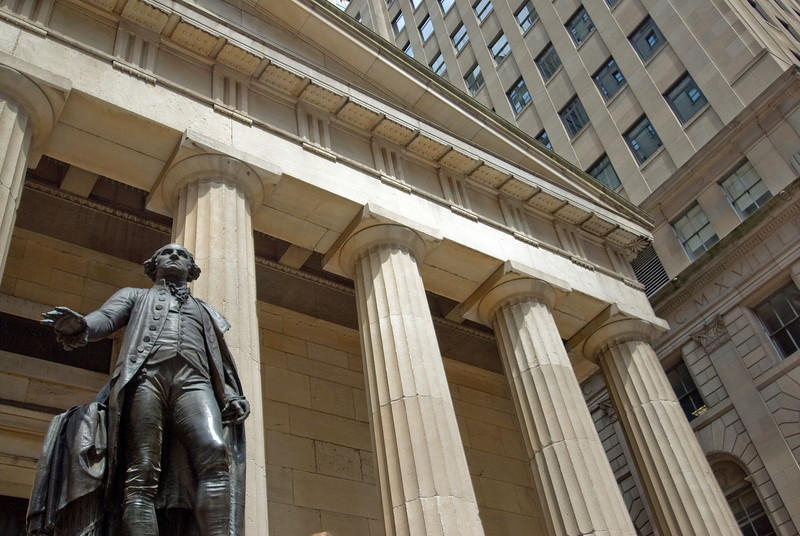 Looking up George Washington statue and the columns at the Federal Hall in New York