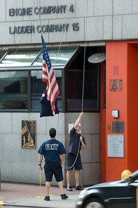 Flag raising at the New York Fire Department headquarters