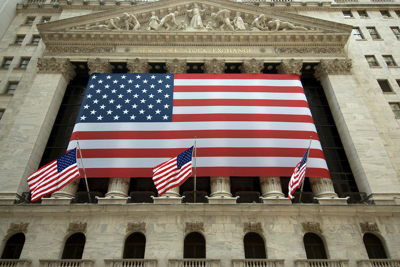 American flag outside New York Stock Exchange in Wall St, New York