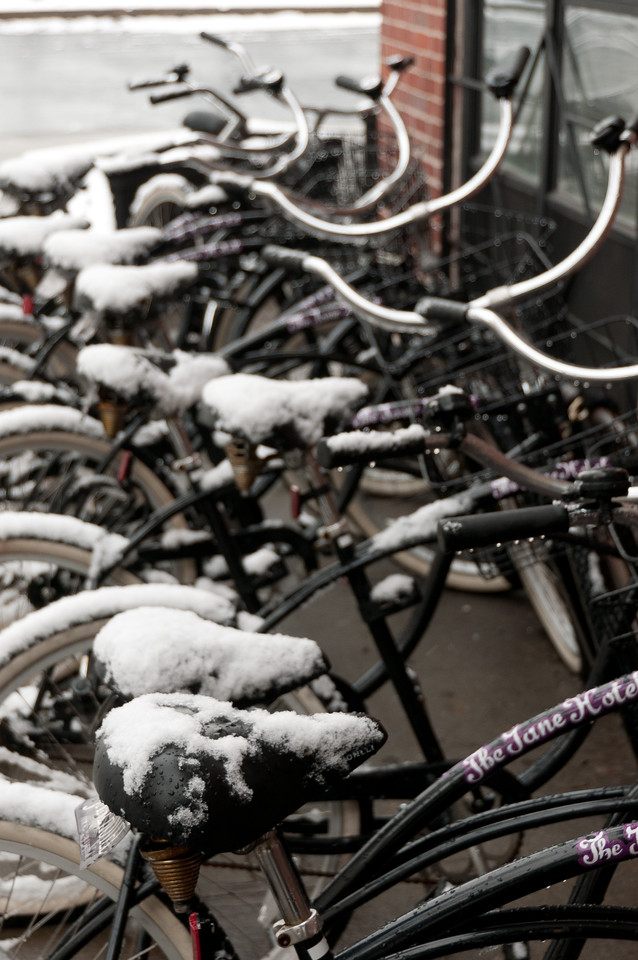 Snow covering parked bikes in New York City, New York