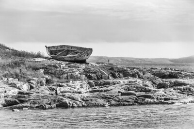 Boat wreck by the shore in Battle Harbour, Canada