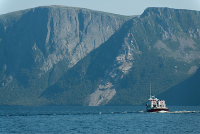 Boat sailing through Western Brook Pond in Gros Morne National Park