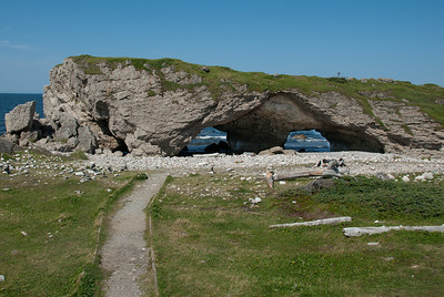 Sea cave at the end of the Green Garden Trail beyond the Tablelands - Gros Morne National Park, Canada